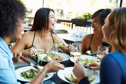 women-laughing-at-restaurant