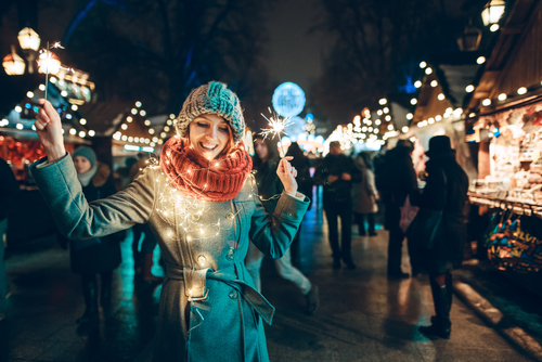 woman-surrounded-in-christmas-lights