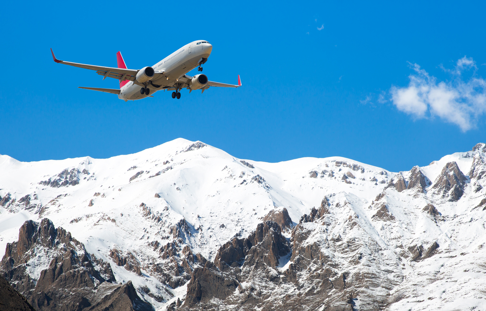 airplane-flying-over-mountains