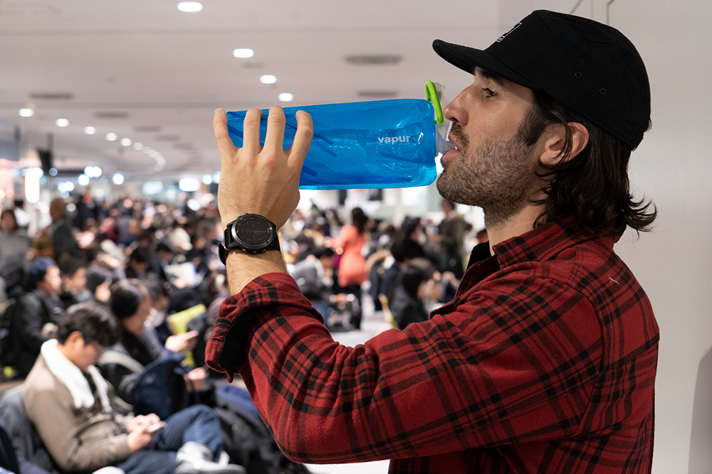 man-drinking-water-bottle