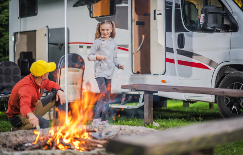 family-by-rv-and-campfire