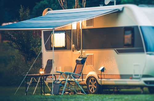 RV-with-awning-and-lawn-chairs