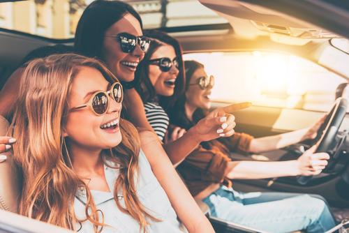 four-girls-driving-around